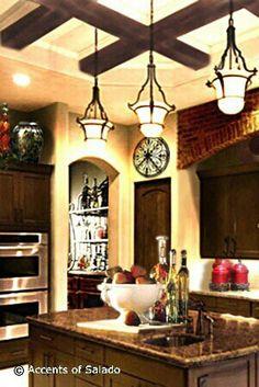 Tuscan style. Rod iron looks good. Dark stain, black appliances, light countertops.
