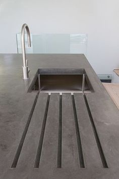 polished concrete work top with drainer grooves                                                                                                                                                      More