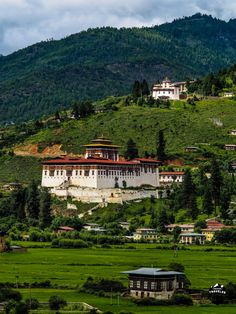 Paro Dzong and Bhutan National Museum in Paro Valley. Even the big city's is…