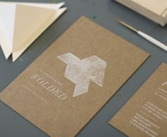 White ink on parchment brown cardstock: pretty with the graphic and large type, but the smaller type is passable.