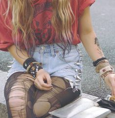 Stud Light Blue Jean Shorts, Bracelets, Bangles, Ripped Up Tights, Purple Tips of Hair, Graphic Tee Shirt, Tattoo. #Grunge