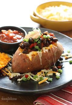 "Loaded baked sweet potato ""Healthified"" from SkinnyTaste - Eat Your Books is an indexing website that helps you find & organize your recipes. Click the ""View Complete Recipe"" link for the original recipe."