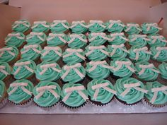 Research for a Breakfast at Tiffany's themed party I am making cupcakes for!  Cute huh?