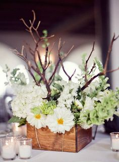 rustic white flowers in wood box wedding centerpiece