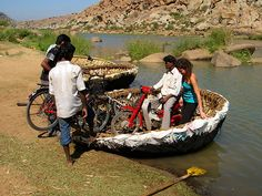 Coracle ferry crossing in Hampi, India