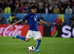 Marco Parolo of Italy scores at the penalty shootout during the UEFA EURO 2016 quarter final match between Germany and Italy at Stade Matmut Atlantique on July 2, 2016 in Bordeaux, France.