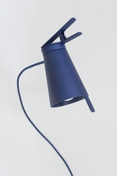 Attach / Bjorn van den Berg  Attach clip lamp is a mobile lightning spot. Out of the strict shape grows the functions for clipping and adjusting the direction of the light. The shade could be tilted and rotated in serval directions, using the lever on the edge. The clip could be attached to various surfaces; horizontally and vertically.