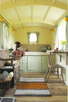 Storage under the bed is essential in English shepherd hut interior design.