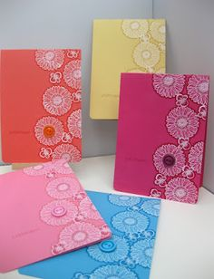 Stampin' Up! ... handmade notecard set ... monochromatic in pretty colors ... heat embossed flowers in white ... used marker matching paper color to out ine .. luv the effect! ... button on one flower as a focal point ... great set!
