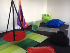Red swing for spinning and swinging, Hangpod for sitting, resting, snuggling and spinning, plus crash mats