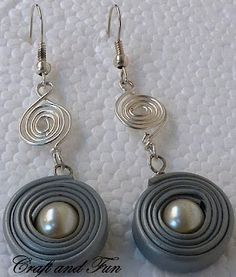 See how  to create earrings  with recycled telephone wires .