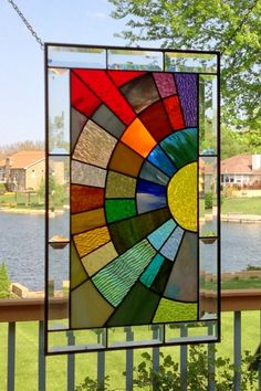This stained glass panel window is a larger size version of my other arched design done in rainbow colors for a geometric effect. The panel size is