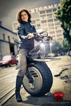 Turn heads with this self-balancing single wheel electric motorcycle. Yes, me wants one.
