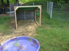 awesome duck house idea.  add third side and board on bottom for keeping more bedding in.