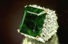 According to legend, this Chalk Emerald was once the centerpiece of an emerald and diamond necklace belonging to a Maharani of the former state of Baroda, India. It originally weighed 38.4 carats, but was recut and set in a platinum and gold ring designed by Harry Winston, Inc., where it is surrounded by 60 pear-shaped diamonds totaling 15 carats. It was donated to the Smithsonian by Mr. and Mrs. O. Roy Chalk in 1972.