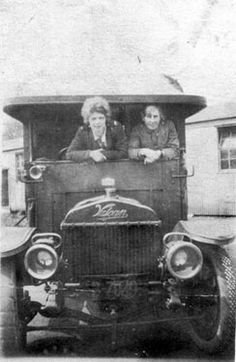 Two women in the cab of an ambulance at Eaton Hall, during Second World War