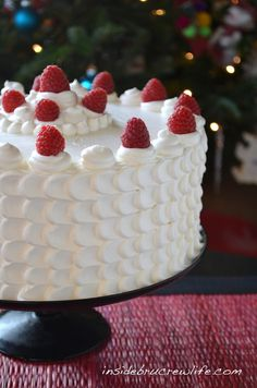 Lemon Cheesecake Cake - 2 lemon cake layers filled with a vanilla cheesecake and topped with Cool Whip frosting #coolwhip #lemon http://www.insidebrucrewlife.com