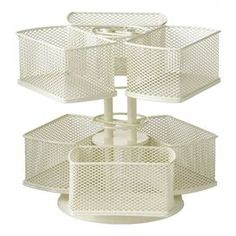 """Organize your vanity with this versatile cosmetic carousel, showcasing multiple compartments to effortlessly locate nail polish, hair bands, and your favorite lipstick shade.    Product: Cosmetic carouselConstruction Material: MetalColor: Cream  Features:   Six baskets to hold cosmeticsRotates 360 degreesTwo tiers   Dimensions: 8.25"""" H x 9"""" Diameter"""
