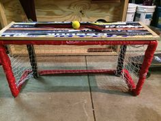Broken hockey's sticks turned into a bench that doubles as a knee hockey net