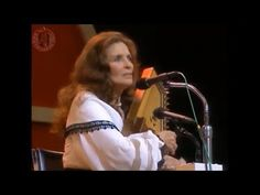 """June Carter Cash - Ring Of Fire (Live Grand Ole Opry) -- Notes: """"""""Ring of Fire"""", or """"The Ring of Fire"""", is a song written by June Carter Cash and Merle Kilgore and recorded by Johnny Cash.The single appears on Cash's 1963 album, Ring of Fire: The Best of Johnny Cash. The song was originally recorded by June's sister, Anita Carter, on her Mercury Records album Folk Songs Old and New (1963) as """"(Love's) Ring of Fire""""."""" READ MORE IN THE NOTES on YouTube"""