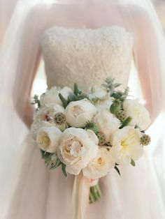 An opulent peony bouquet for the classic bride. #wedding (Photo by: Elizabeth Messina)