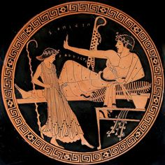 """A youth reclines at a symposium, holding an aulos (double flute), while a woman dances in front of him.  The accompanying inscription reads ΠΙΛΙΠΟΣ ΚΑΛΛΙΣΤΟ<Σ> (""""Philip is most handsome/beautiful"""").  Tondo of an Attic red-figure kylix, attributed to the Brygos Painter; ca. 490-480 BCE.  Found at Vulci; now in the British Museum."""