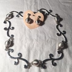 """Brighton Bellows necklace & earrings. 2pc set. Brighton long Bellows sweater necklace retails at $98 with pearl like beads on silver. Selling AsIs.  Some of The beads have a few scuffs on them. Not all of them do. Earrings have never been worn, but have a scuff from being stored in their Tin. NWT $34. Necklace is 42"""" long. Earrings 1.5"""". Great set. Earrings come with tin. Necklace does not. Brighton Jewelry Necklaces"""