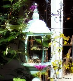 old light fixture into bird feeder and garden decoration