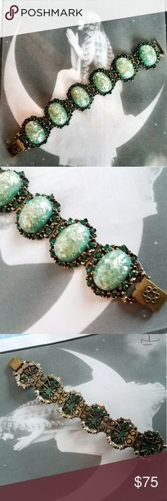 Vintage chunky confetti lucite bracelet green gold This awesome vintage bracelet is from around the 1950s! It has big confetti lucite glitter cabochons in sea green surrounded by sparkly dark green rhinestones. It has dark gold tone metal and a foldover clasp. This is a big, chunky statement piece in great condition! From a smoke free home:)    8188gem8c6d Vintage Jewelry Bracelets