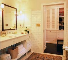 Wonderful updated vintage looking bathroom.  Subway tiles, vintage floor tiles, chrome accents, great rug, walk-in closet.  ~UR