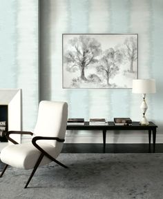 Soft Blue Ombre Stripe Wallcovering with Moody Tree Canvas Art from Wallquest's Essence Collection