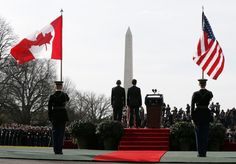 President Barack Obama and Canadian Prime Minister Justin Trudeau, stand on the dias during an arrival ceremony on the South Lawn of the White House in Washington, Thursday, March 10, 2016.