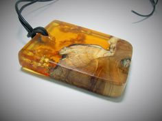 Medium size wood resin fusion pendant. Translucent amber resin and cedar wood pendant.
