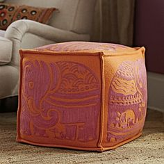 Orange pouf with pink elephant. Love the sofa on the back, does anybody know what model is it?