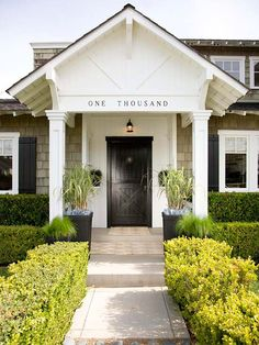 We love this elegant entry! More ways to enhance your front entry: http://www.bhg.com/home-improvement/exteriors/curb-appeal/enhance-front-entry/?socsrc=bhgpin081613blackdoor=1