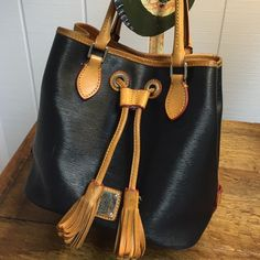 D&B Barlow Satchel Bag Saffiano Leather Drawstring Bag. Sophisticated style and relaxed touch Satchel. I have it for about a year still in good condition normal wear. Navy Blue. Dooney & Bourke Bags Satchels