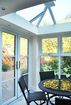 Beautiful Internal View, of Our Ultraframe Sky Light In our Fantastic Orangery/Sunroom, with Full Rehau High Quality Sash Horned Windows, Astragal Bars Running Throughout and Open out French Doors, all finished off with Golden Fixtures and Fittings.