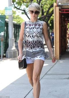 Looking toned! Hough showed off her svelte pins and toned arms while strolling in the sun...