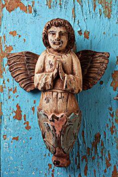 Angel on blue wooden door