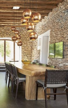 Dining room of Villa Lavanda in Ibiza with beautiful autentic stone walls and wooden beams
