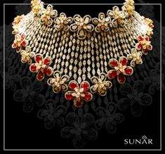 This magnificent queenly artwork is exclusively designed by SUNAR. This exquisite Diamond Necklace is #designed with sharp pin-up curves and the lipstick red stones are all set to give you that sensual connotation that you have been looking for.