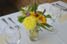 Simple Spring Arrangement  Yellow Dahlia, seasonal greenery, and wild flowers Brooklyn Wedding