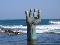 The Hand of Harmony is one of several sculptures on Homigot Beach, the eastern point of South Korea.  The rays of the rising sun are first to reach the hands signifying a new beginning for South Korea.