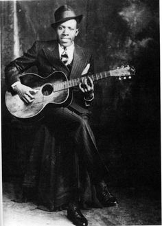 Robert Johnson - American Blues Singer :: His style of singing, guitar skills, and songwriting has influenced generations of musicians of all genres.  He is a true blues legend. #GraveyardGreats #RobertJohnson