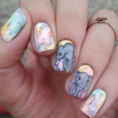 Watercolor nails with elephant nail art accents.