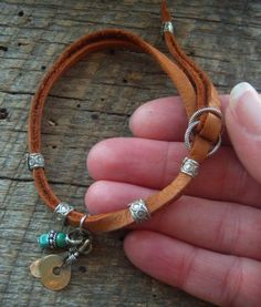 Indian Charm Looped Leather Bracelet. $18.00, via Etsy.: