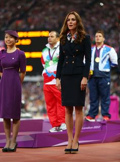 September 3, 2012: Kate participated in a Paralympic medal ceremony, crowning Team GB's Aled Davies with a gold for men's discus. She's wearing a navy blazer by Pucci, a Paralympic Team GB scarf and Stuart Weitzman wedges.