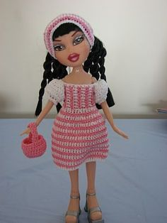 Here is this week's free crochet pattern:  Fashion Doll Picnic Set .  It features a lovely stripped dress with puffed sleeves, pink picni...
