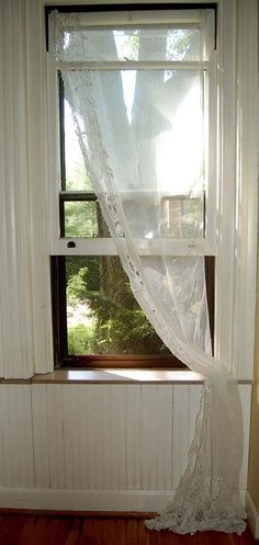This is ... to state it simply...pleasing. Oddly enough, I've never had curtains on a window in any home we've ever owned. We've always lived in pretty and private spaces. And I've preferred my views left unfettered.