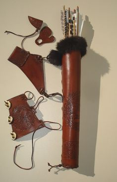 Hip Quiver & Arm Guard in a Tooled Archery Leather Set. $240.00, via Etsy.